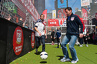 Former national team member Jimmy Conrad and former men's national team player Cobi Jones go for the ball during a small sided game during the centennial celebration of U. S. Soccer at Times Square in New York, NY, on April 04, 2013.