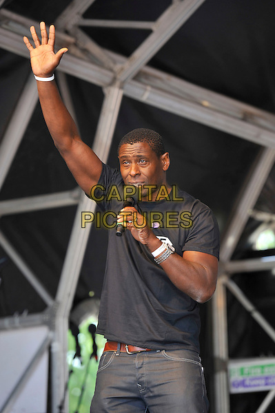 David Harewood<br /> attending The Big IF, Hyde Park, London, England. <br /> 8th June 2013<br /> half length black t-shirt hand arm in air microphone  <br /> CAP/MAR<br /> &copy; Martin Harris/Capital Pictures
