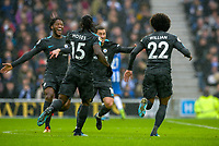 Willian of Chelsea (22) Celebrates scoring his sides second goal and Celebrates with team mates  during the Premier League match between Brighton and Hove Albion and Chelsea at the American Express Community Stadium, Brighton and Hove, England on 20 January 2018. Photo by Edward Thomas / PRiME Media Images.