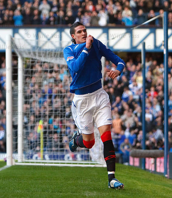 Kyle Lafferty kisses the Rangers badge after scoring