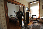 A tour guide points to the spot where Ronald Reagan was born in a modest apartment his parents kept above a bar in Tampico, Illinois on October 26, 2008.