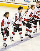 Rachel Llanes (NU - 11), Autumn Prouty (NU - 10), Casie Fields (NU - 9), Alyssa Wohlfeiler (NU - 8) - The Harvard University Crimson defeated the Northeastern University Huskies 4-3 (SO) in the opening round of the Beanpot on Tuesday, February 8, 2011, at Conte Forum in Chestnut Hill, Massachusetts.