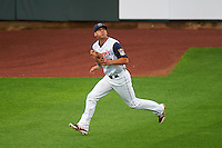 Cedar Rapids Kernels outfielder Zack Larson (24) tracks a fly ball during a game against the Kane County Cougars on August 18, 2015 at Perfect Game Field in Cedar Rapids, Iowa.  Kane County defeated Cedar Rapids 1-0.  (Mike Janes/Four Seam Images)