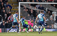 Goalkeeper Jamal Blackman of Wycombe Wanderers pulls off a save & Michael Harriman of Wycombe Wanderers clears the danger during the Sky Bet League 2 match between Grimsby Town and Wycombe Wanderers at Blundell Park, Cleethorpes, England on 4 March 2017. Photo by Andy Rowland / PRiME Media Images.