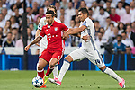 Thiago (L) of FC Bayern Munich vies for the ball with Carlos Henrique Casemiro (R) of Real Madrid during their 2016-17 UEFA Champions League Quarter-finals second leg match between Real Madrid and FC Bayern Munich at the Estadio Santiago Bernabeu on 18 April 2017 in Madrid, Spain. Photo by Diego Gonzalez Souto / Power Sport Images