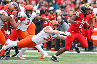 College Park, MD - October 27, 2018: Maryland Terrapins running back Tayon Fleet-Davis (8) avoids the tackle by Illinois Fighting Illini linebacker Jake Hansen (35) during the game between Illinois and Maryland at  Capital One Field at Maryland Stadium in College Park, MD.  (Photo by Elliott Brown/Media Images International)