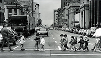 KIDS ON A ROPE: Group of children taken across a streen in downtown Oakland, California. (photo 1986 by Ron Riesterer)