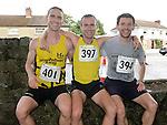 Gary O'Hanlon first, Daragh Greene second and Brian McCluskey third in the Turfman 10K run in Ardee. Photo:Colin Bell/pressphotos.ie