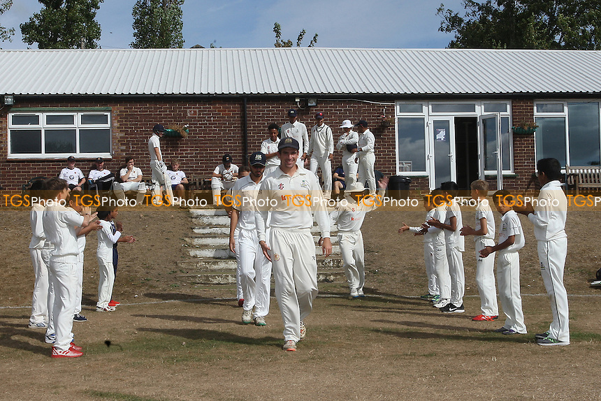 Wanstead players applauded onto the pitch during Wanstead and Snaresbrook CC vs Colchester and East Essex CC, Shepherd Neame Essex League Cricket at Overton Drive on 1st September 2016