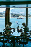 CANADA, Vancouver BC, a couple dines at Port by the Canada Place inside of the Holland America cruise ship, the Oosterdam, British Columbia