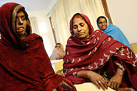 Acid victimes are chatting in a bedroom at the Acid Survivors Foundation center in Islamabad, Pakistan-2009