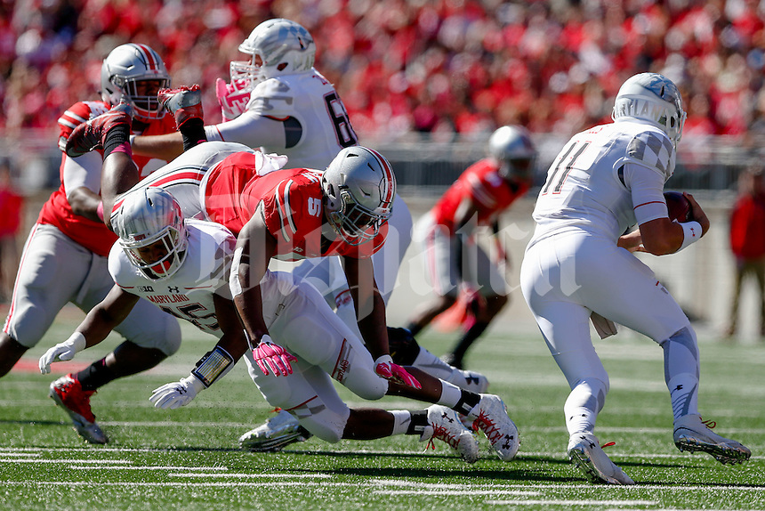 Ohio State Buckeyes linebacker Raekwon McMillan (5) is blocked by Maryland Terrapins running back Brandon Ross (45) as he tries to pressure Maryland Terrapins quarterback Perry Hills (11) during a NCAA college football game between the Ohio State Buckeyes and the Maryland Terrapins on Saturday, October 10, 2015 at Ohio Stadium in Columbus, Ohio. (Joshua A. Bickel/The Columbus Dispatch)
