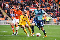 Garry Thompson of Wycombe Wanderers gets to the ball ahead of Sam Slocombe of Blackpool during the Sky Bet League 2 match between Blackpool and Wycombe Wanderers at Bloomfield Road, Blackpool, England on 20 August 2016. Photo by James Williamson / PRiME Media Images.