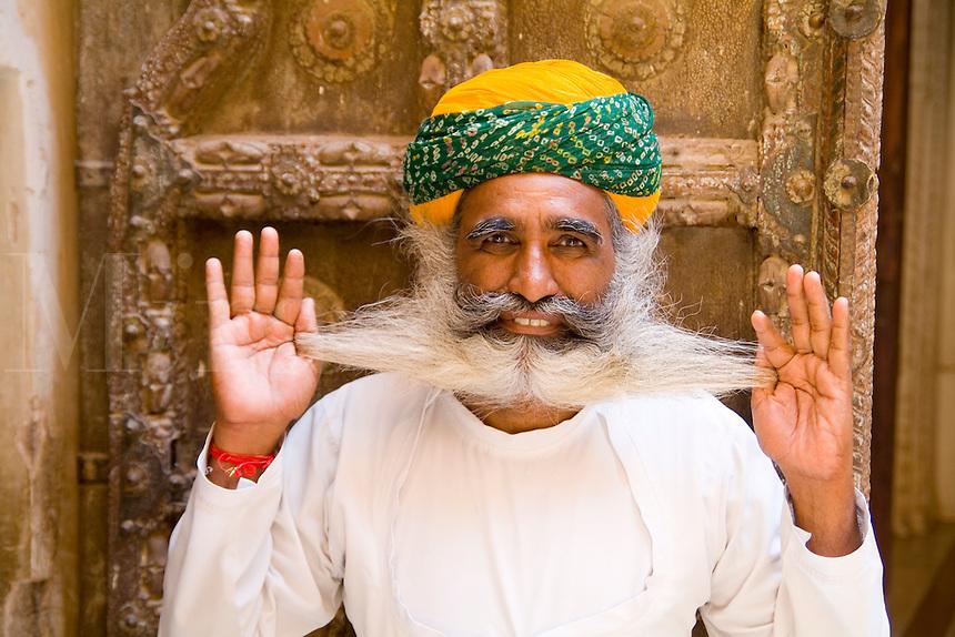 Jodhpur, Fort Mehrangarh, Rajasthan, India Bearded guard  in doorway of Fort Palace.