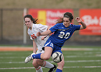 NWA Democrat-Gazette/BEN GOFF @NWABENGOFF<br /> Lanee Knight (26) of Rogers Heritage and Grace Carrol (20) of Rogers try to control the ball Friday, March 17, 2017, during the game in Gates Stadium at Rogers Heritage.