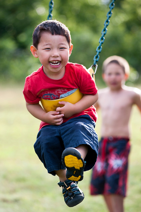 Holden Miller, 3, plays on a swing set during a four-year-old birthday party for MacKenzie Stute at the Stute home in Baraboo, Wis., on June 19, 2010.