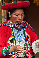 Quechua woman works wool into yarn, Cusco Peru, South America