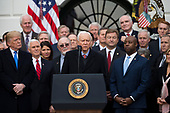 United States Senator Orrin Hatch, Republican of Utah, speaks on the South Lawn of the White House surrounded by United States President Donald J. Trump, United States Vice President Mike Pence, and Republican members of Congress after the United States Congress passed the Republican sponsored tax reform bill, the 'Tax Cuts and Jobs Act' in Washington, D.C. on December 20th, 2017. Credit: Alex Edelman / CNP