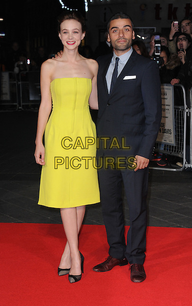 Carey Mulligan, Oscar Isaac<br /> 'Inside Llewyn Davis' Centrepiece Gala during the 57th BFI London Film Festival, Odeon West End cinema, Leicester Square, London, England, 15th October 2013<br /> full length yellow strapless dress black shoes suit <br /> CAP/DS<br /> &copy;Dudley Smith/Capital Pictures