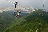 The exciting 25-minute cable car ride on the Ngong Ping 360 Skyrail from Po Lin Monastery to Tung Chung Village on the Hong Kong Island of Lantau, travels past the Hong Kong International Airport. Opened for commercial operations in 1998, the airport is on its own island called Chek Lap Kok, which was a small hilly island before it was flattened..