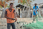 A year after Hurricane Matthew ravaged parts of Haiti, men prepare their nets for fishing off the coast of northwestern Haiti near the village of Plateforme. The village was ravaged in the storm, and Lutheran World Relief, a member of the ACT Alliance, has helped the community rebuild its economy with fishing materials, a solar-powered refrigerator room for storing their catch, and other assistance.