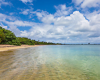 Vieques, Puerto Rico<br /> Calm caribbean waters on a beach near Pt. Caballo with puffy cumulus clouds