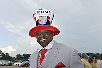 """8/24/16 Jackson,MS. Trump supporter Philemom Williams sports a searsucker suit and hand made Trump hat while he waits to get into the rally in Jackson Mississippi. Williams said Trump had his vote from hte moment he announced he was running for President.  Republican Presidential candidate Donald J. Trump stumps in Jackson Mississippi at the coliseum to a full house of supporters and calls Hillary Clinton a """"bigot"""" during his speech. While in Jackson Trump also made time to squeezed in a very private $1,000 dollar  per person fundraiser. It was so private you did not get the address for the location until the campaign received your donation. Photo © Suzi Altman"""