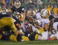 Stanford Cardinal running back Stepfan Taylor (33) last attempt to stretch the ball over the line comes up short, sealing the 20-13 Irish win.