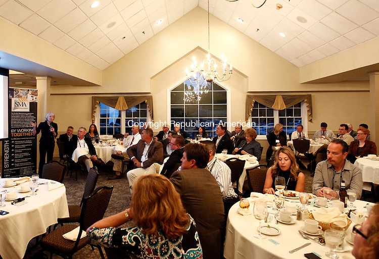 Watertown, CT- 15 September 2014-091514CM04- Department of Economic and Community Development Commissioner Catherine Smith, left, gives a lecture during a Smaller Manufacturers Association's dinner meeting at the Watertown Country Club on Monday.  Christopher Massa Republican-American