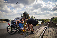 Rescue personnel help Hersey Kirk into a restraint as a rescue helicopter hovers in the distance after she was rescued from her home flooded by Hurricane Harvey in Rose City, Texas, U.S. on August 31, 2017.