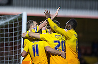 The team celebrate with goalscorer Paul Hayes (left) of Wycombe Wanderers during the Sky Bet League 2 match between Dagenham and Redbridge and Wycombe Wanderers at the London Borough of Barking and Dagenham Stadium, London, England on 9 February 2016. Photo by Andy Rowland.