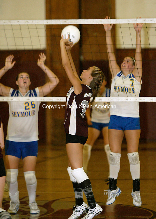 NAUGATUCK, CT 9/11/07- 091107BZ12- Naugatuck's Lindsay Witkoski (33) sets the ball against Seymour during their match at Naugatuck High School Tuesday night.<br /> Jamison C. Bazinet Republican-American