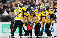 October 31, 2009; Hamilton, ON, CAN;  Hamilton Tiger-Cats defensive end Garrett McIntyre (71) celebrates recovering a Saskatchewan Roughriders fumble with defensive lineman Justin Hickman (95), defensive tackle Matt Kirk (93) and linebacker Markeith Knowlton (25). CFL football: Saskatchewan Roughriders vs. Hamilton Tiger-Cats at Ivor Wynne Stadium. The Tiger-Cats defeated the Roughriders 24-6. Mandatory Credit: Ron Scheffler. Copyright (c) 2009 Ron Scheffler.