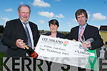 WINNER: Eileen Lenihan accepted her 5,000 cheque at the Lee Strand Headquarters on Tuesday afternon. From l-r were: Bill Kennedy (Manager Lee Strand) Eileen Lenihan (winner) and Tim O'Keeffe (Financial Controller),.