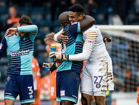 Big well done hug for Goalkeeper Jamal Blackman of Wycombe Wanderers from Adebayo Akinfenwa during the Sky Bet League 2 match between Wycombe Wanderers and Blackpool at Adams Park, High Wycombe, England on the 11th March 2017. Photo by Liam McAvoy.