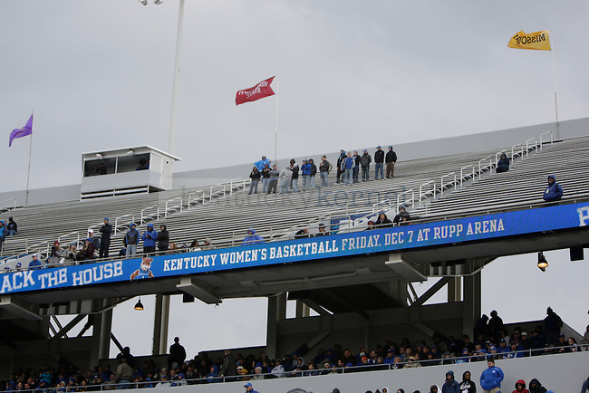 Kentucky fans brave the rain and cold on the baren upper deck in Commonwealth Stadium during the game against Vanderbilt Saturday November 3, 2012. Photo by Scott Hannigan