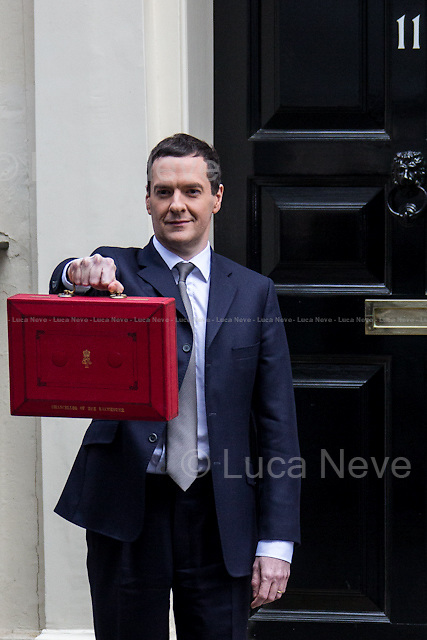 "London, 18/03/2015. UK Chancellor of the Exchequer, George Osborne (followed by his team) shows the ""red box"" (Budget Box) containing the Budget for the fiscal year 2015."