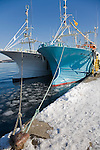 Shiretoko Peninsula, Hokkaido Island, Japan<br /> Bows of ice fishing boats docked at Rausau village harbor