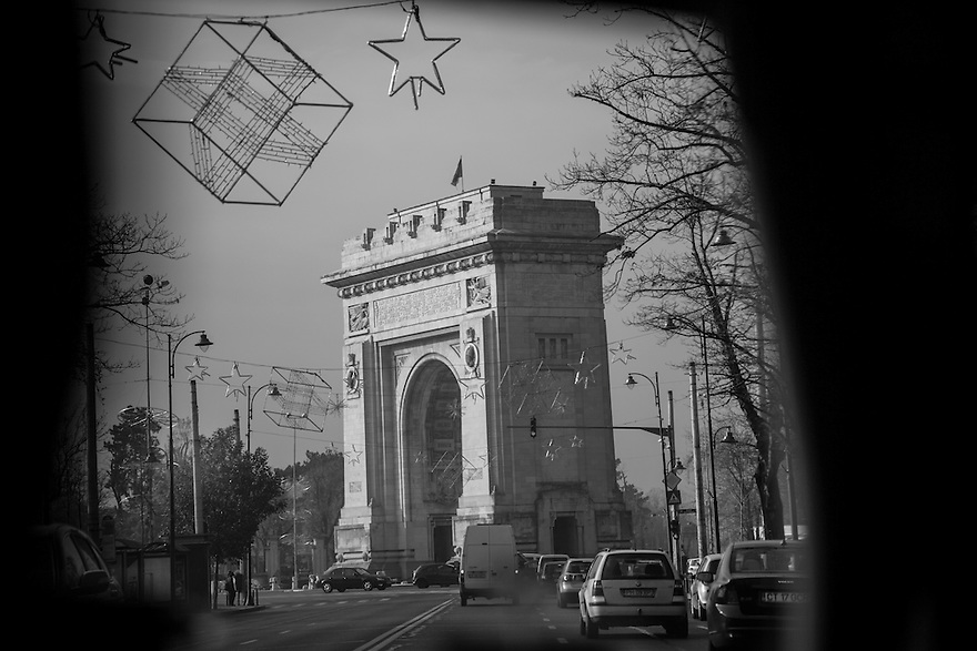 The Arcul de Triumf in Bucharest, a city with close cultural ties to France and western Europe, is still plagued by problems of poverty and homelessness 24 years after the fall of Communism.