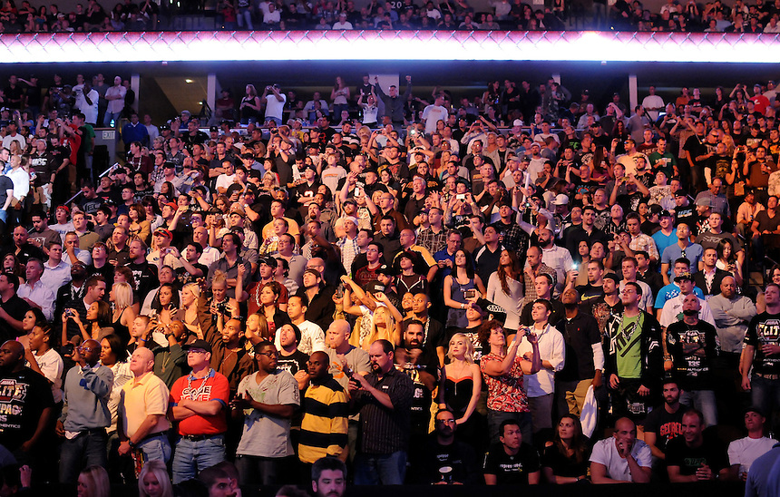 24 SEPTEMBER 2011:  The crowd at the Pepsi Center cheers the beginning of the title bout   during UFC 135 at the Pepsi Center in Denver, Colorado. *****For Editorial Use Only*****