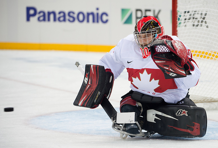 Sochi, RUSSIA - Mar 11 2014 -  Corbin Watson prepares to make a save as Canada takes on Czech Republic in Sledge Hockey at the 2014 Paralympic Winter Games in Sochi, Russia.  (Photo: Matthew Murnaghan/Canadian Paralympic Committee)