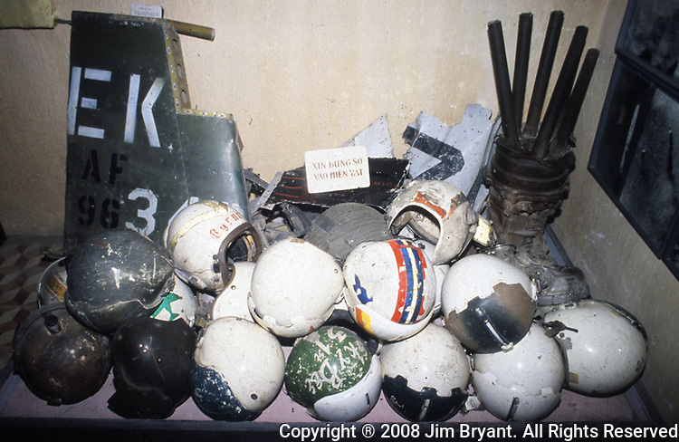 Captured American helmets and pieces of downed aircraft are on display in Hanoi's Armed Forces Military Museum which houses treasured war trophies from the French and American wars, along with many from the Cambodian and Chinese fronts in Hanoi, North Vietnam. (Jim Bryant Photo).....