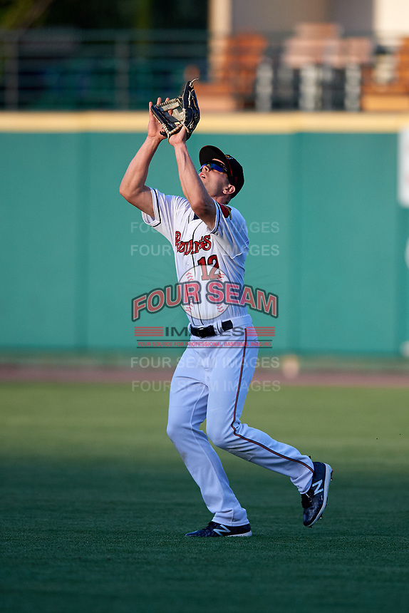 Rochester Red Wings right fielder Nick Buss (12) settles under a fly ball during a game against the Pawtucket Red Sox on May 19, 2018 at Frontier Field in Rochester, New York.  Rochester defeated Pawtucket 2-1.  (Mike Janes/Four Seam Images)