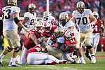 Wisconsin Badgers gang tackle during an NCAA College Football Big Ten Conference game against the Purdue Boilermakers Saturday, October 14, 2017, in Madison, Wis. The Badgers won 17-9. (Photo by David Stluka)