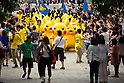 "Visitors take pictures of 20 Pikachus marching on the street during the parade at the ""1000 Pikachu Outbreak! at Yokohama Minatomirai"" on August 09, 2014. 1000 Pikachu performed at different areas of Minatomirai in Yokohama during the summer vacation event from August 9 to 17.  (Photo by Rodrigo Reyes Marin/AFLO)"