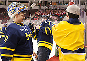 Drew Vogler (Merrimack - 31) watches Aaron Titcomb (Merrimack - 3) and Tim Burke (Merrimack) have a water bottle fight. - The Boston University Terriers defeated the visiting Merrimack College Warriors 4-0 (EN) on Friday, January 29, 2016, at Agganis Arena in Boston, Massachusetts.