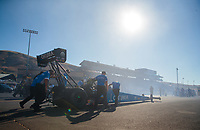 Jul 26, 2019; Sonoma, CA, USA; Crew members push the car of NHRA top fuel driver Leah Pritchett during qualifying for the Sonoma Nationals at Sonoma Raceway. Mandatory Credit: Mark J. Rebilas-USA TODAY Sports