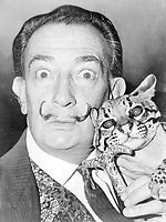 "n 	<br /> English: Salvador Dali with ocelot and cane.<br /> Date 	<br /> <br /> 1965<br /> Source 	<br /> <br /> Library of Congress. New York World-Telegram & Sun Collection. http://hdl.loc.gov/loc.pnp/cph.3c14985<br /> Author 	<br /> <br /> Roger Higgins, World Telegram staff photographer - Salvador Domènec Felip Jacint Dalí i Domènech, Marquis de Púbol (May 11, 1904 – January 23, 1989), commonly known as Salvador Dalí  was a prominent Spanish Catalan surrealist painter born in Figueres.<br /> <br /> Dalí was a skilled draftsman, best known for the striking and bizarre images in his surrealist work. His painterly skills are often attributed to the influence of Renaissance masters.His best-known work, The Persistence of Memory, was completed in 1931. Dalí's expansive artistic repertoire includes film, sculpture, and photography, in collaboration with a range of artists in a variety of media.<br /> <br /> Dalí attributed his ""love of everything that is gilded and excessive, my passion for luxury and my love of oriental clothes to a self-styled ""Arab lineage,"" claiming that his ancestors were descended from the Moors.<br /> <br /> Dalí was highly imaginative, and also had an affinity for partaking in unusual and grandiose behavior. His eccentric manner and attention-grabbing public actions sometimes drew more attention than his artwork to the dismay of those who held his work in high esteem and to the irritation of his critics -"