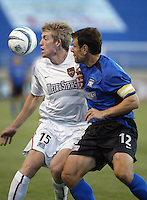 John Wolyniec (15) and Jeff Agoos (12) in action during an MLS match between the San Jose Earthquakes and MetroStars on June 13, 2004 in San Jose, California.  San Jose defeated the MetroStars 3-1.