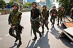 14 MAY 2010 - BANGKOK, THAILAND: Thai troops patrol Rama IV Road in Bangkok Friday after clearing about 50 meters of the road of anti-government protesters who attacked the troops with rocks and home made explosives. Thai troops and anti government protesters clashed on Rama IV Road Friday afternoon in a series of running battles. Troops fired into the air and at protesters after protesters attacked the troops with rocket and small homemade explosives. Unlike similar confrontations in Bangkok, these protesters were not Red Shirts. Most of the protesters were residents of nearby Khlong Toei slum area, Bangkok's largest slum area. The running battle went on for at least two hours.   PHOTO BY JACK KURTZ